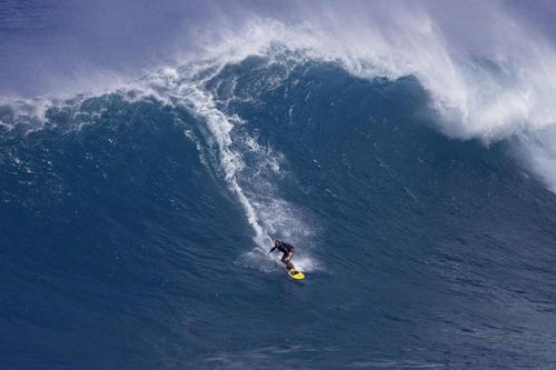 Andreas first ride at Jaws : photo courtesy Mauisurfergirls.com